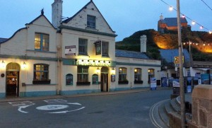 The Pier Tavern Ilfracombe, with Lantern hill in the background